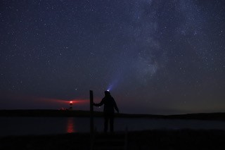 Dani on Ynys Enlli, looking at the Milky Way