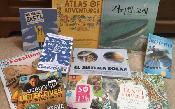 A selection of books about nature, in multiple languages